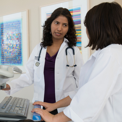A staff physician consults with a colleague